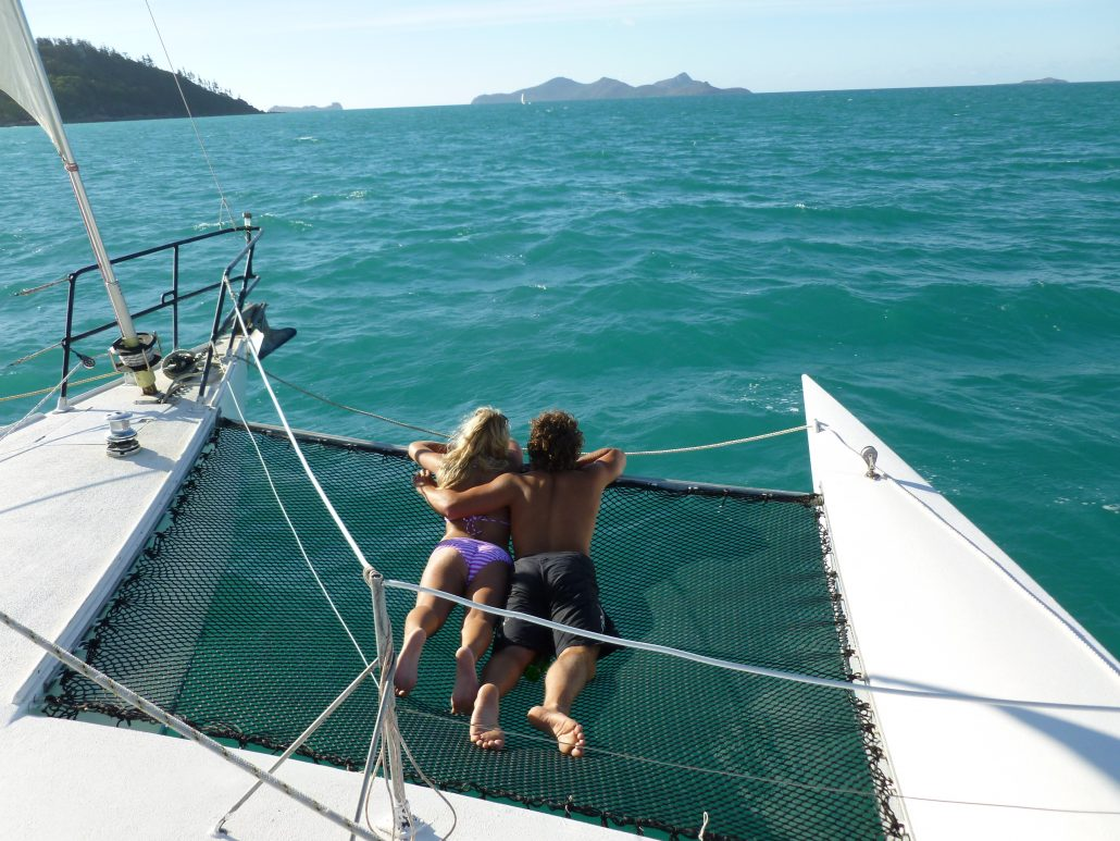 Trimaran delivered to the Whitsundays. Crew enjoying the sun. QLD