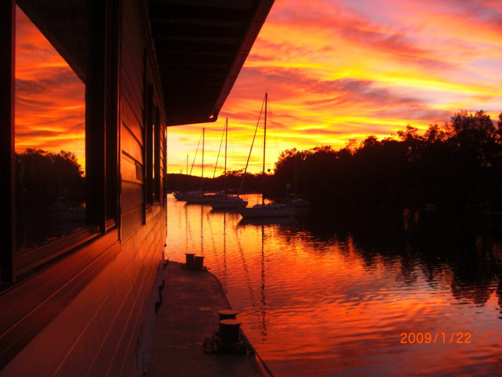 Sunset sunrise on David Mitchell Houseboat Lake Macquarie NSW Austalia